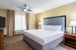 A bed or beds in a room at Homewood Suites by Hilton St. Louis Riverport- Airport West
