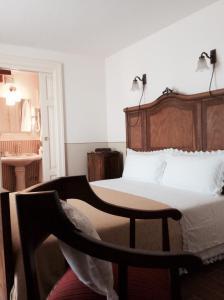 Letto o letti in una camera di Casa Moccia - Maison D'antan