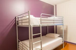 A bunk bed or bunk beds in a room at Broadway Hotel & Hostel