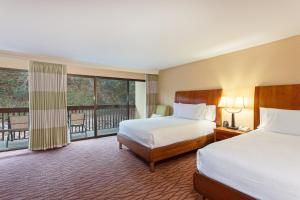 A bed or beds in a room at Hilton Garden Inn Monterey