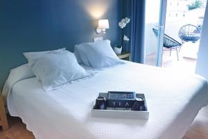 A bed or beds in a room at Thalassa Sport Spa