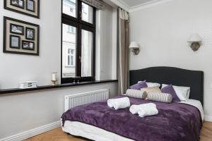 A bed or beds in a room at Bijoux Apartment in Heart of Kazimierz by Otium