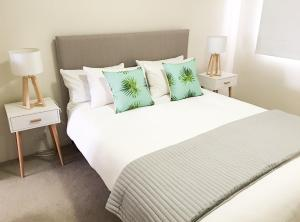 A bed or beds in a room at Seaspray Villa 5