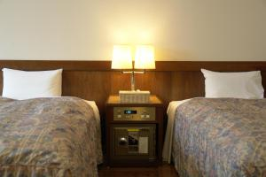 旅の宿 らくちんにあるベッド