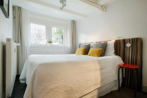 Ein Bett oder Betten in einem Zimmer der Unterkunft CoHo Apartment Suites