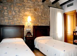 A bed or beds in a room at Hotel Restaurante Verdia