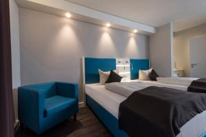 A bed or beds in a room at Best Western Hotel Cologne Airport Troisdorf