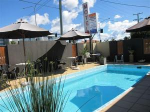 The swimming pool at or near Horizons Motel