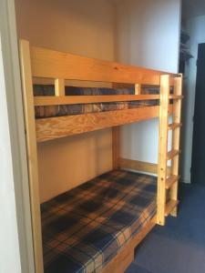 A bunk bed or bunk beds in a room at Studio Tignes Le Lavachet