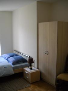 Un ou plusieurs lits dans un hébergement de l'établissement Maison Monsieur