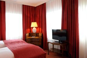 تلفاز و/أو أجهزة ترفيهية في فندق فير يارستزايتن سالزبورغ