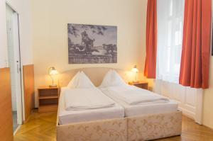 Кровать или кровати в номере Pension Lehrerhaus