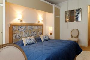 Un ou plusieurs lits dans un hébergement de l'établissement Domaine d'Auriac - Relais & Châteaux