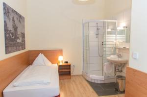 Ванная комната в Pension Lehrerhaus