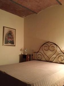 Letto o letti in una camera di Podere il Castellaccio Pianetti