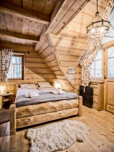 A bed or beds in a room at Zakopane Best