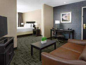 A bed or beds in a room at Valley Forge Casino Resort