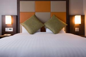 Letto o letti in una camera di Miyako Hotel Kyoto Hachijo