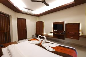 A television and/or entertainment center at Raj Residency