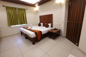 A bed or beds in a room at Raj Residency