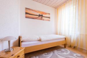 Ein Bett oder Betten in einem Zimmer der Unterkunft Apartments Ilmtal-Jena