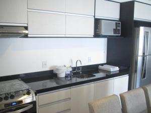 A cozinha ou cozinha compacta de Apartamento Gales Ingleses