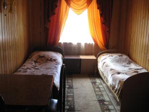 A bed or beds in a room at Guest House Alyana
