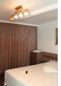 A bed or beds in a room at AZZA Aparthotel