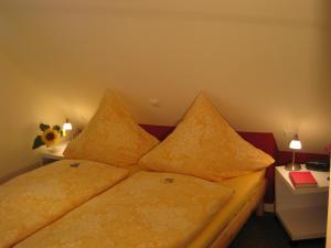 Ein Bett oder Betten in einem Zimmer der Unterkunft Ferienhaus Wind