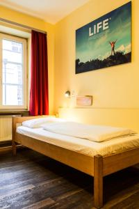 A bed or beds in a room at Euro Youth Hotel Munich