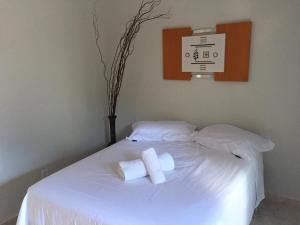 A bed or beds in a room at Mambaí Inn