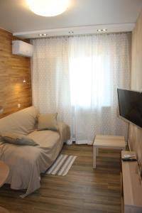 A bed or beds in a room at Apartment on Lenina 146