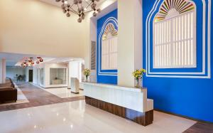 The lobby or reception area at Sterling Goa Varca