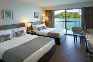A bed or beds in a room at Novotel Suva Lami Bay
