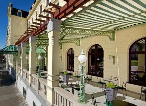 Een restaurant of ander eetgelegenheid bij Clarion Grandhotel Zlaty Lev