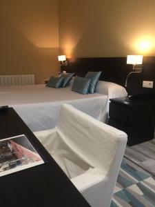 Cama o camas de una habitación en Hotel Felix