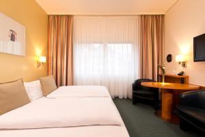 Ein Bett oder Betten in einem Zimmer der Unterkunft Hotel am Borsigturm