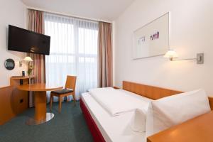 TV/Unterhaltungsangebot in der Unterkunft Hotel am Borsigturm
