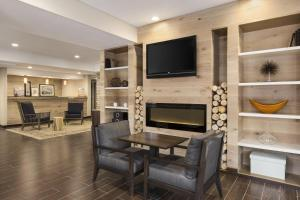 A television and/or entertainment center at Country Inn & Suites by Radisson, Flagstaff, AZ