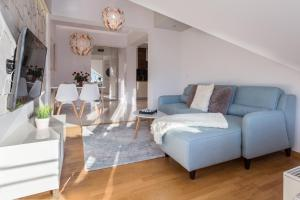 A seating area at VIP Apartamenty Stara Polana