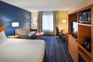 A television and/or entertainment center at Fairfield Inn & Suites by Marriott Toronto Brampton