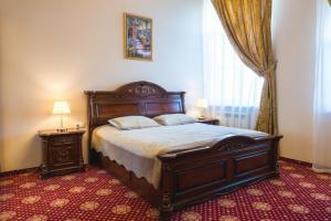 Кровать или кровати в номере Прованс Отель