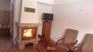 Telewizja i/lub zestaw kina domowego w obiekcie Chatka Bukowina