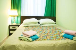 Кровать или кровати в номере Es Hotels Network St. Petersburg