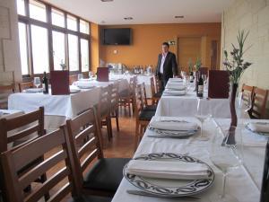 Un restaurante o sitio para comer en O Curruncho dos Lopez