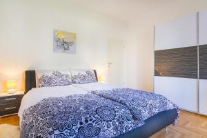 A bed or beds in a room at Villa Apartments Futura