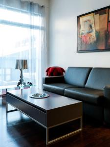 A seating area at Room With a View Apartments