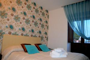 A bed or beds in a room at Abraxia B&B