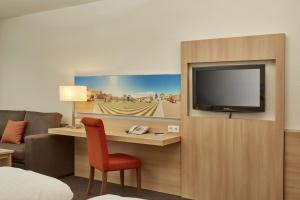 TV/Unterhaltungsangebot in der Unterkunft H+ Hotel Darmstadt