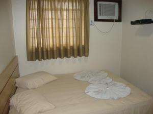 A bed or beds in a room at Hotel Mato Grosso